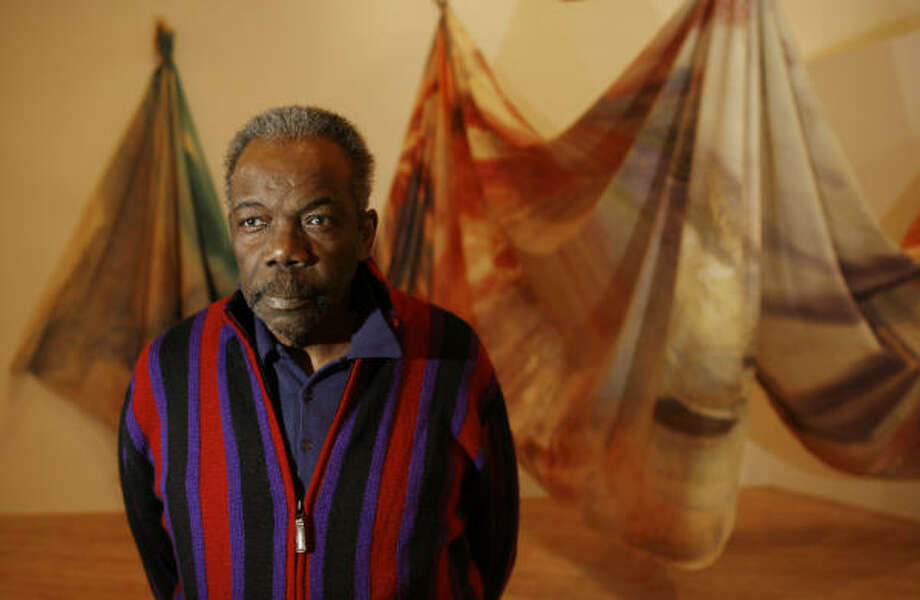 The Contemporary Arts Museum will feature a retrospective of Sam Gilliam's work. Behind Gilliam is his Light Depth (1969). Photo: MELISSA PHILLIP, HOUSTON CHRONICLE