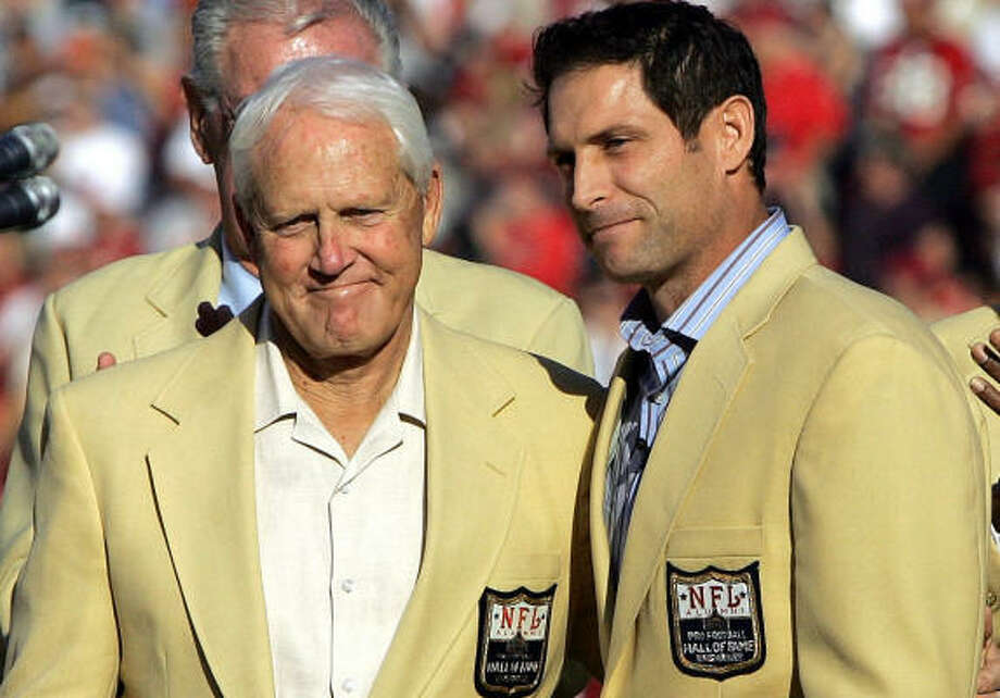 Former 49ers quarterback Steve Young, center, was joined by Bill Walsh during a halftime ceremony honoring Young's induction into the Pro Football Hall of Fame in 2005. Photo: JEFF CHIU, AP