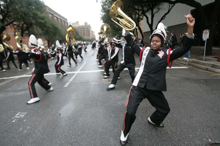 The Pine Bluff High School Marching Band freestyles during the Martin Luther King Grande Parade last year. After this year's parade, marching bands across the nation will again compete in the High School Battle of the Bands at Berry Center Stadium; 8877 Barker Cypress Road in Cypress. Photo: MAYRA BELTRÁN, CHRONICLE