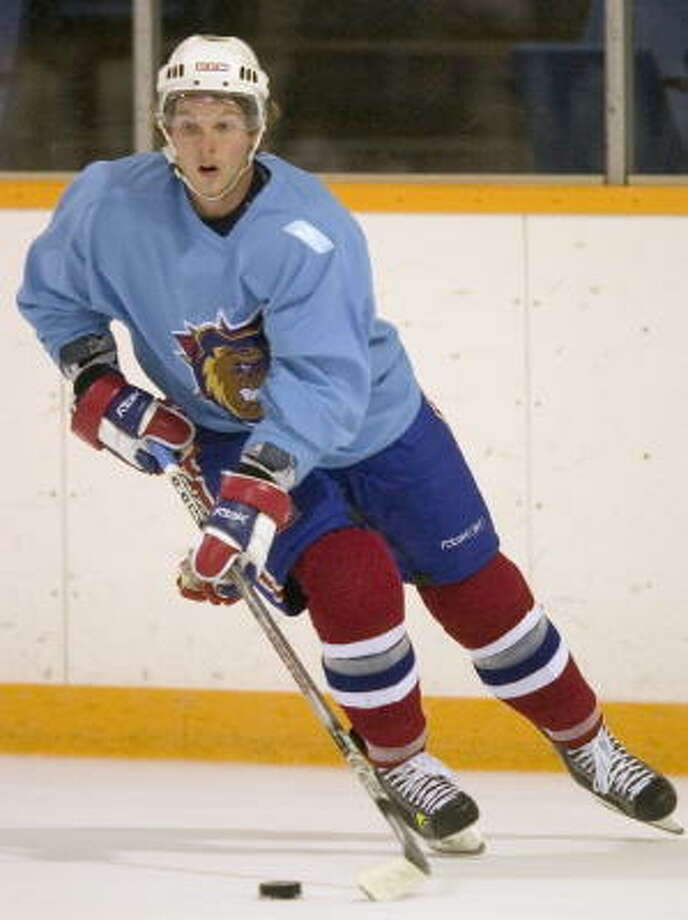 File photo: Hamilton Bulldogs center Corey Locke skates with the puck during the hockey team's practice in Hamilton, Ontario. The Minnesota Wild traded defenseman Shawn Belle to the Montreal Canadiens for Locke and signed minor-leaguer Krys Kolanos to a two-way contrac. Photo: Ron Pozzer, AP