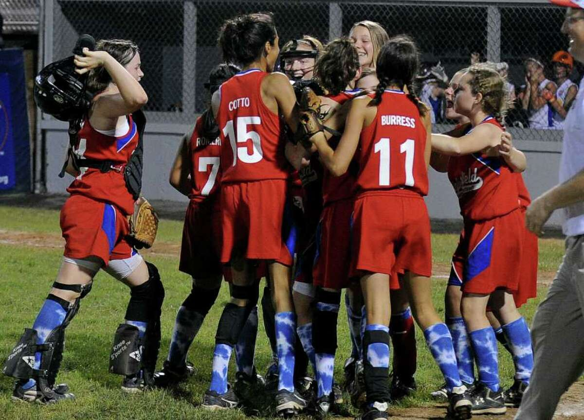Fairfield celebrates its win over Maine 7-6, during the 2011 Little League Softball Eastern Regional in Bristol, Conn. on Friday July 29, 2011.