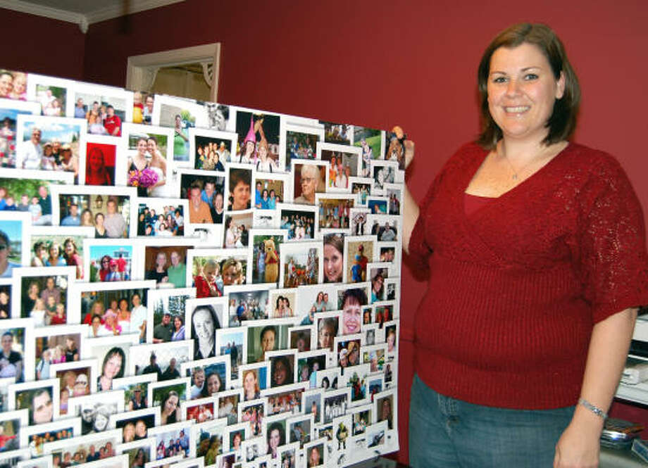 FACES OF SUPPORT: Angela Jackson stands next to a poster board showing photos of people who followed her sister Julie Lyons' battle with cancer on a blog Lyons wrote prior to her death in 2007. Photo: Wendy Rudnicki, For The Chronicle