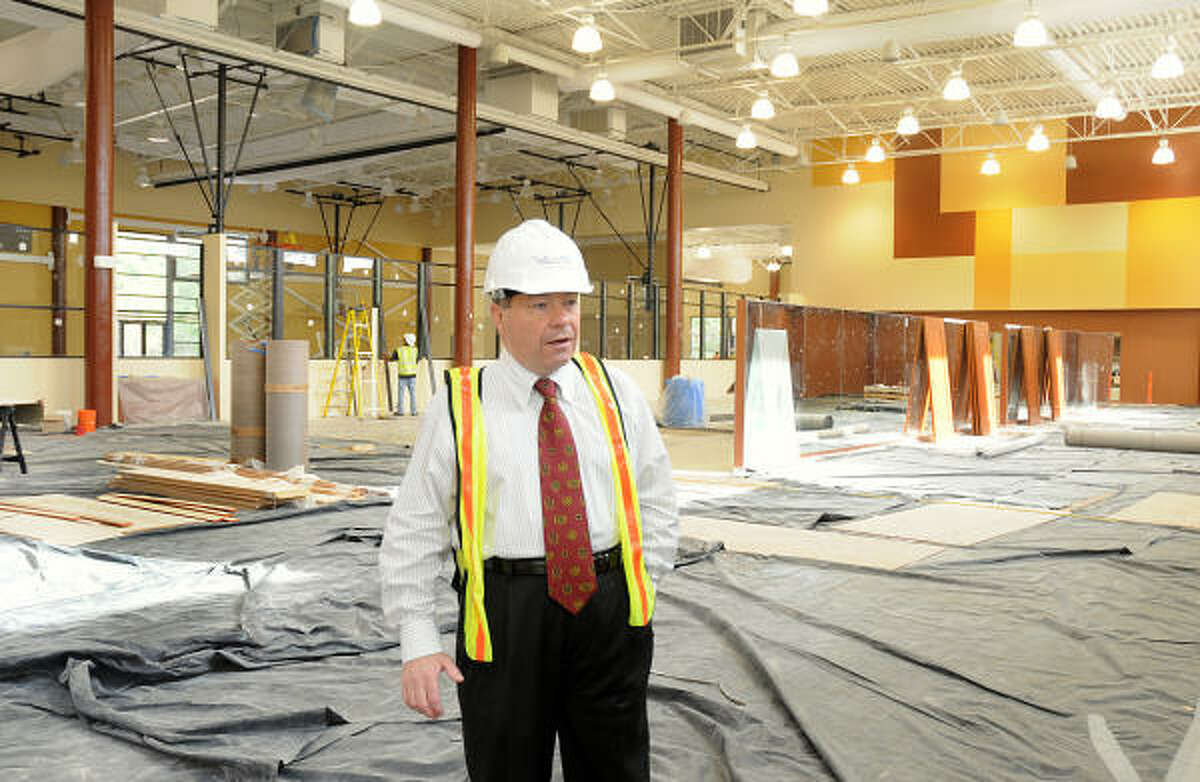 Villa Sports president Tom Lyneis looks over the interior construction at the Villa Sports new building, 4141 Technology Forest Drive in The Woodlands. The new high-end athletic center is scheduled to open by mid-May.