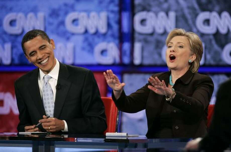 Democratic presidential hopefuls Sen. Hillary Clinton and Sen. Barack Obama joke around at the end of the Jan. 31 debate. The two are expected to increase their presence in Texas between now and the March 4 primary. Photo: CHRIS CARLSON, ASSOCIATED PRESS