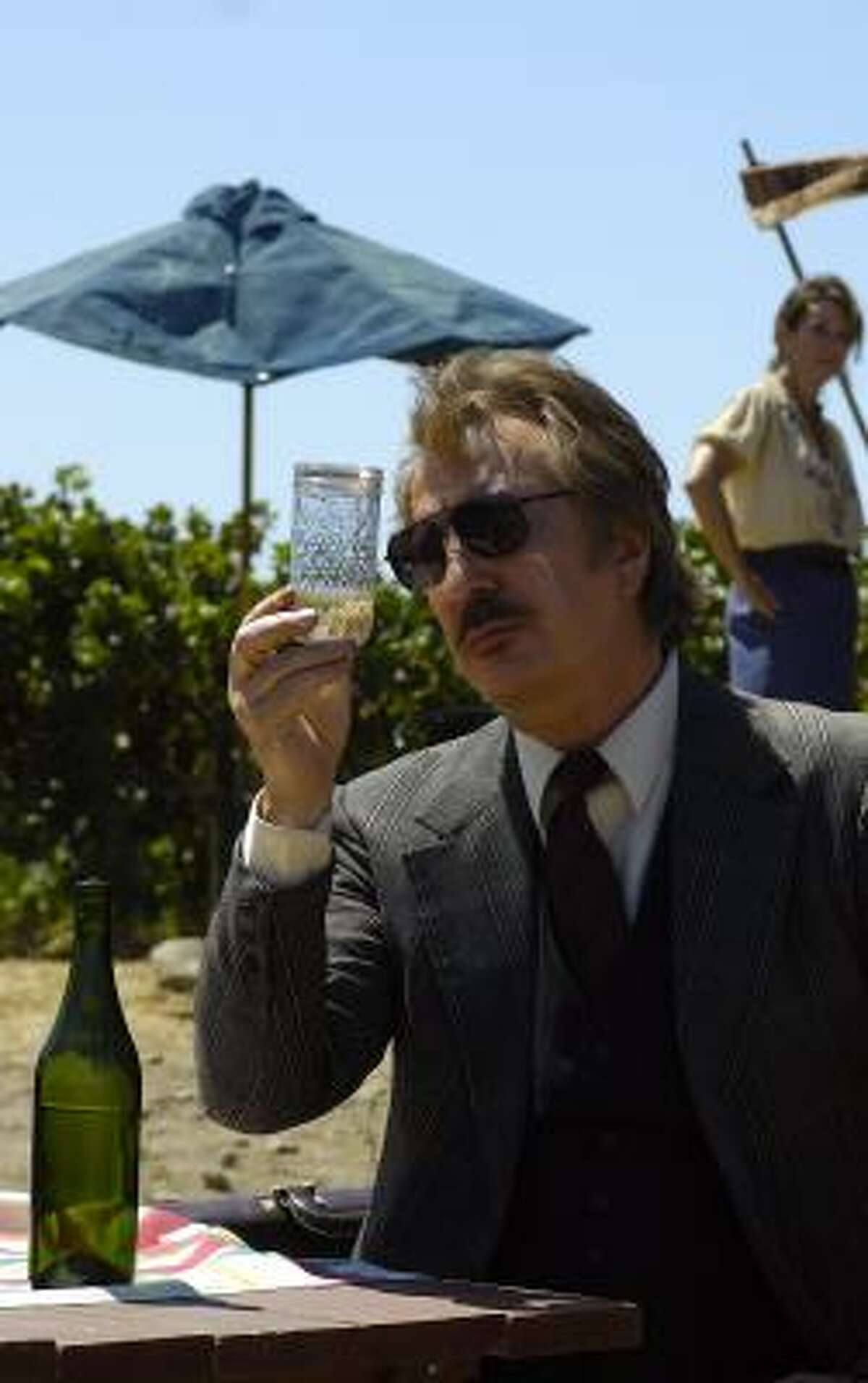Steven Spurrier (Alan Rickman) examines a bottle of wine in Bottle Shock.