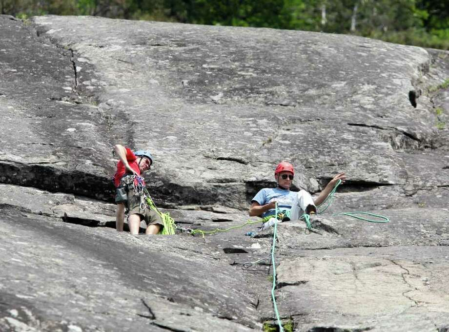ADVANCE FOR WEEKEND EDITIONS, JULY 30-31 - In this photo taken July 20, 2011, Phil Brown of Saranac Lake, N.Y., left, and Associated Press writer Michael Virtanen are seen after finishing the second pitch of Little Finger at Roger's Rock in Hague, N.Y. (AP Photo/Mike Groll) Photo: Mike Groll