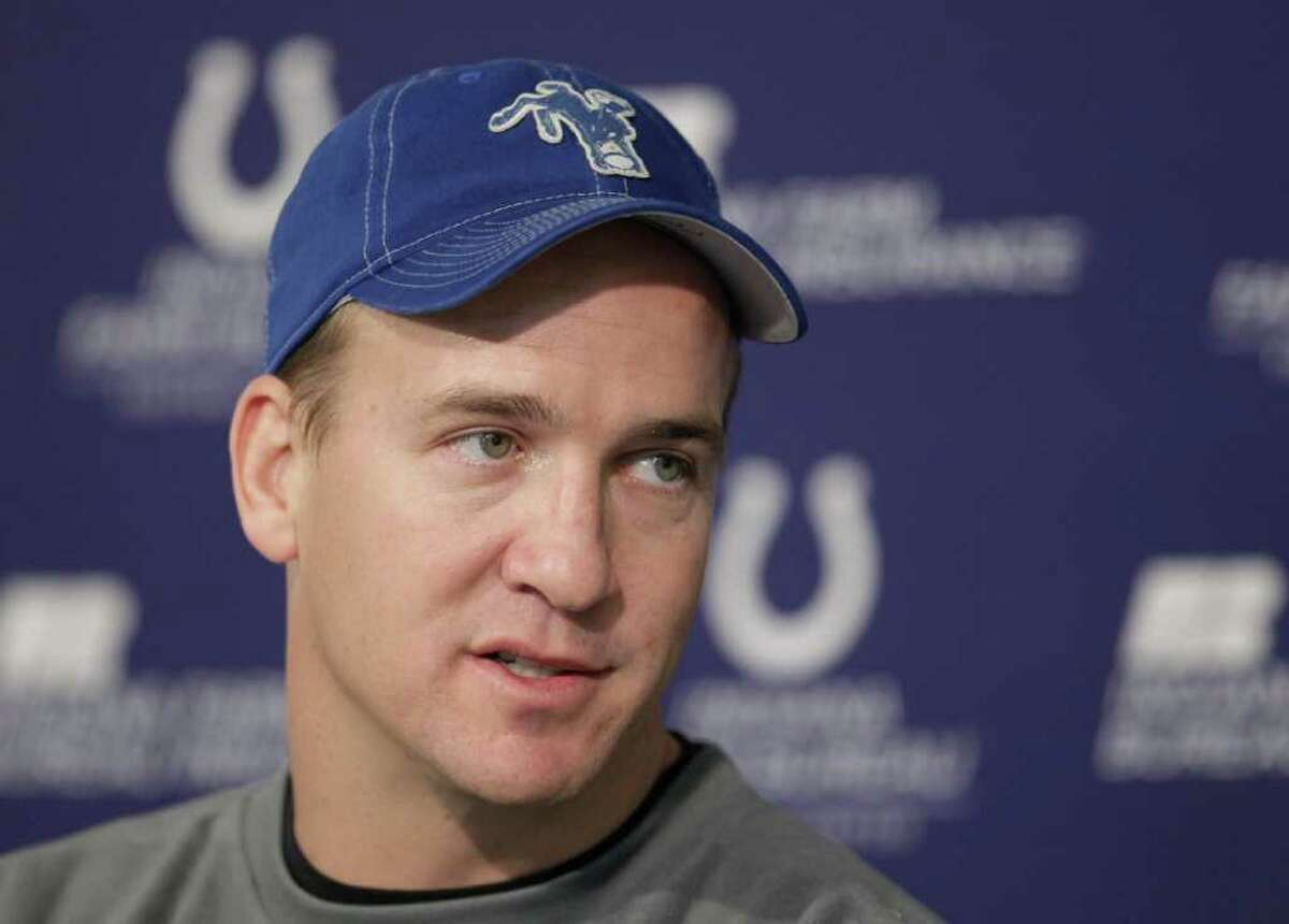 FILE - This Jan. 4, 2011, file photo shows Indianapolis Colts quarterback Peyton Manning talking to reporters in Indianapolis. NFL owners and players agreed early Monday, July 25, 2011 to the terms of a deal to end the lockout, and players were expected to begin the voting process later in the day, two people familiar with the negotiations told The Associated Press. The people spoke on condition of anonymity because the process was supposed to remain secret and no formal announcement had been made. (AP Photo/Darron Cummings, File)