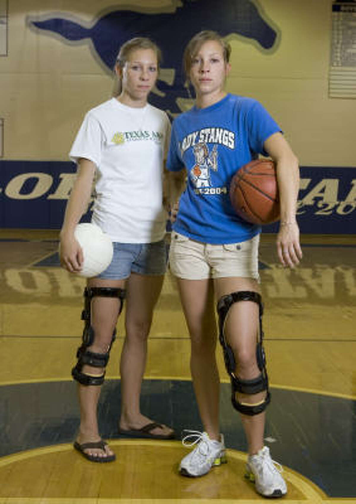 Twins Kara, left, and Julie Kroll, 18, both suffered torn ACLs during their athletic careers at Katy Taylor. Kara, a volleyball and basketball player, injured her knee in a preseason game her junior year. Julie, a basketball player, injured her knee in an AAU game her sophomore year and then again playing for Taylor in February.
