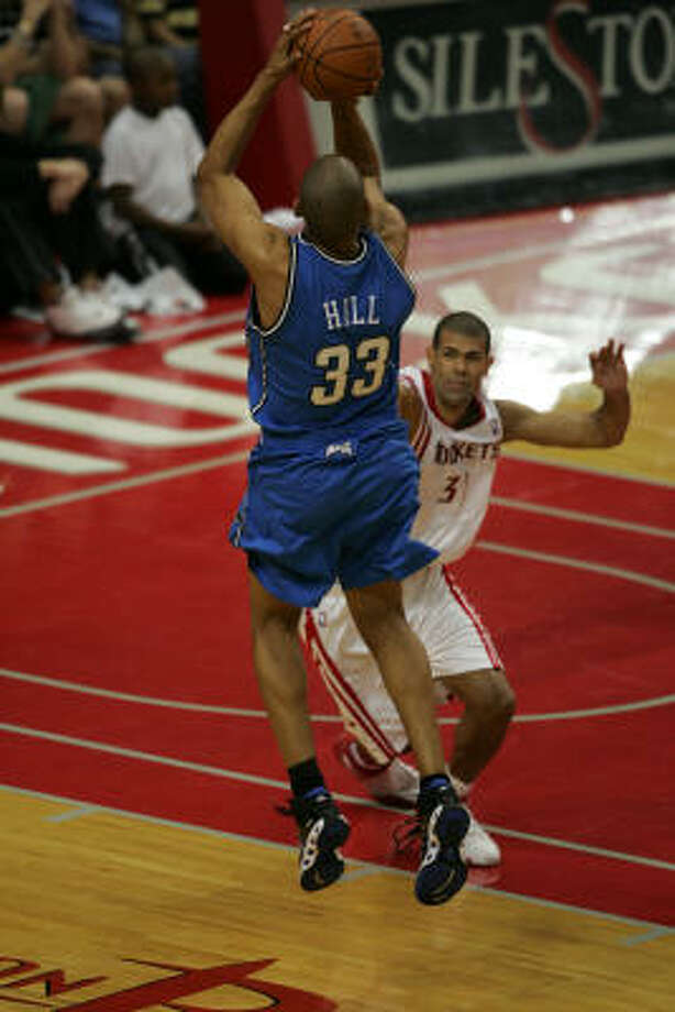 Grant Hill takes aim over Shane Battier. The former All-Star finished with 17 points in 30 minutes. Photo: Margaret Bowles