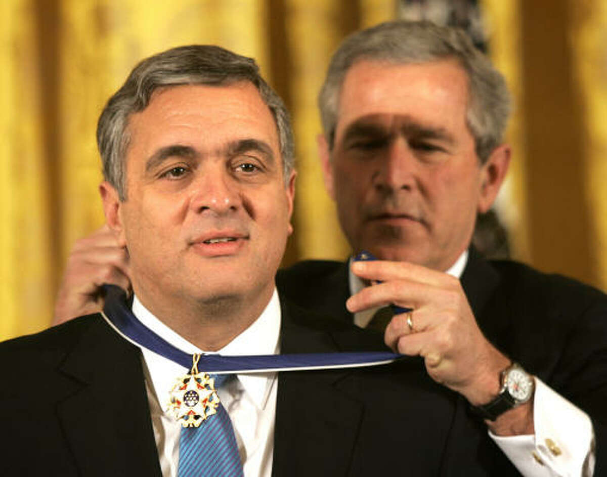 President Bush presents then Central Intelligence Agency director, George Tenet, the Presidential Medal of Freedom Award, the nation's highest civilian honor, in 2004. Tenet's new book says the Bush White House rushed into the Iraq war.