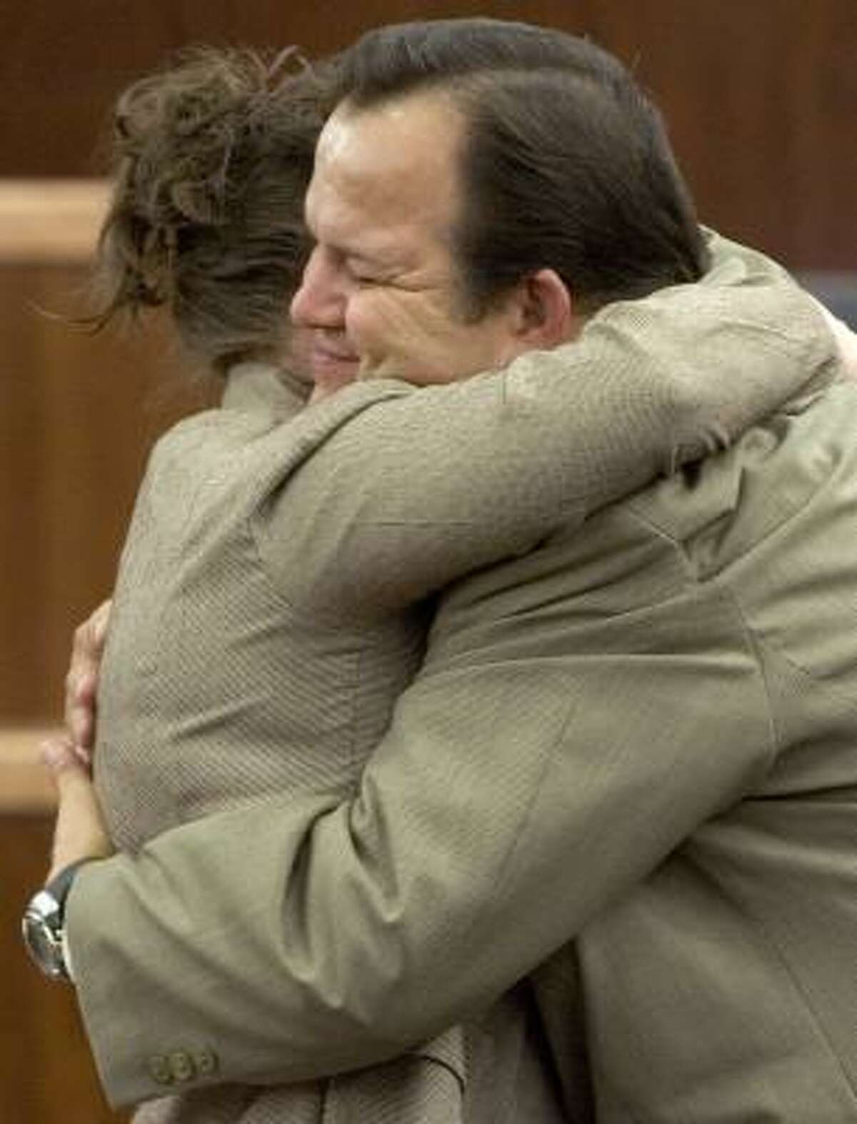 Former Pasadena bus driver Jerry Cook hugs his wife, Annette, after Thursday's verdict.