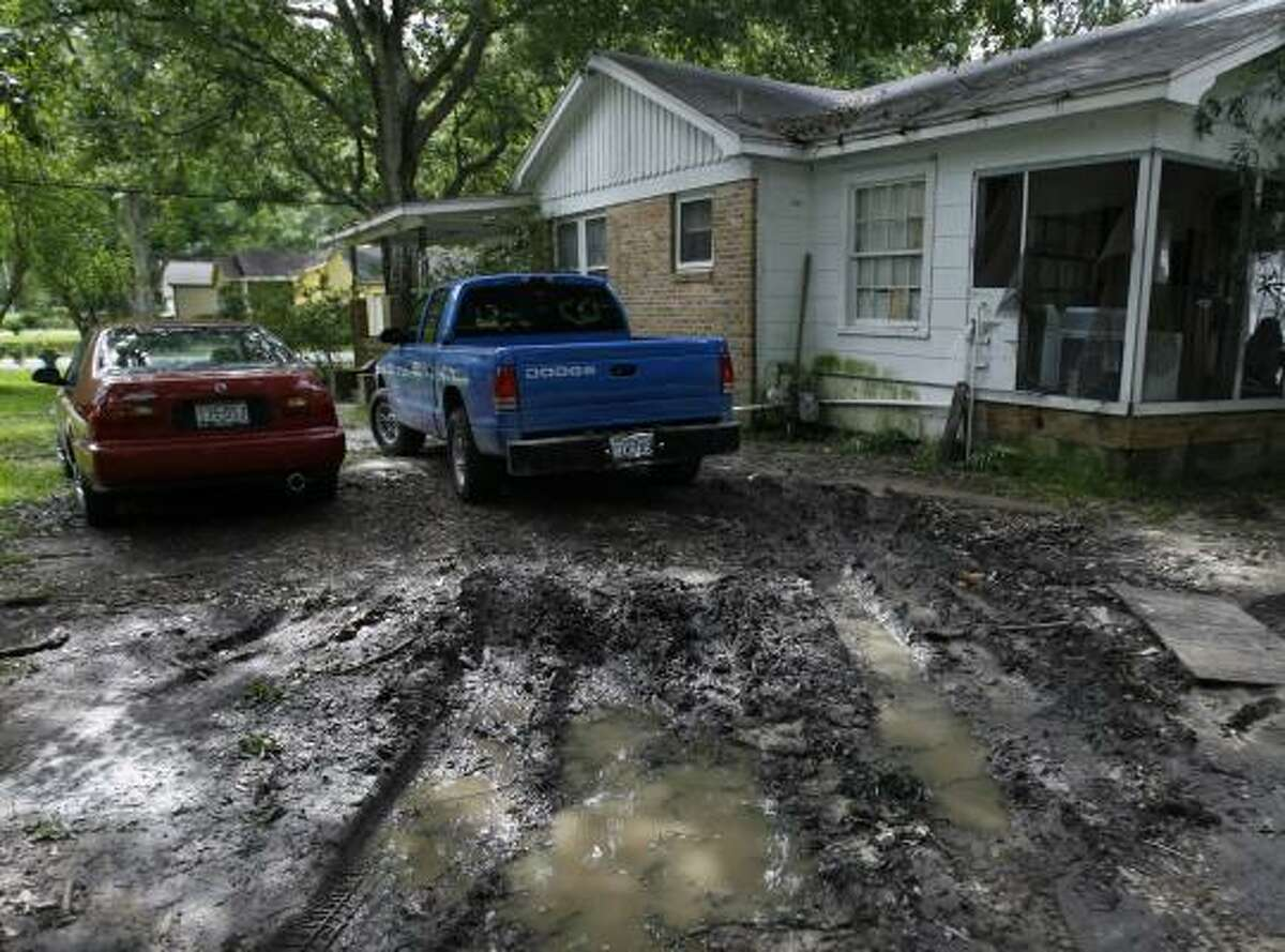 The owners of this northwest Houston home would have to put down a parking slab for their vehicles under the proposal.