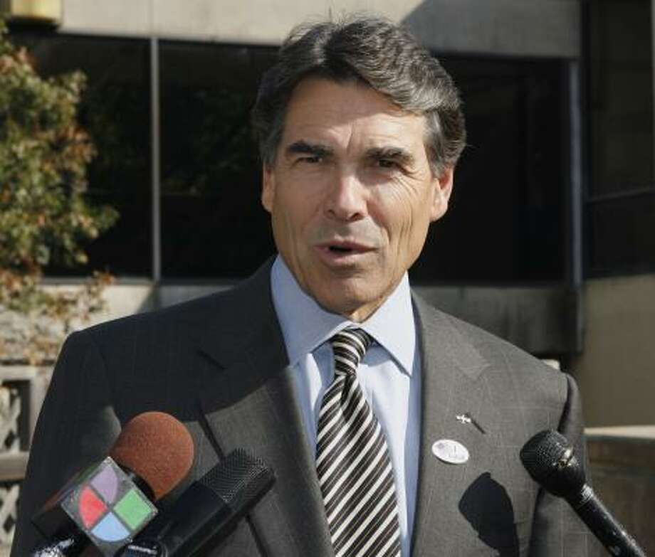 """Gov. Rick Perry still supports public college tuition deregulation and thinks Texas universities are """"still a bargain,"""" according to a spokeswoman. Photo: Harry Cabluck, Associated Press"""