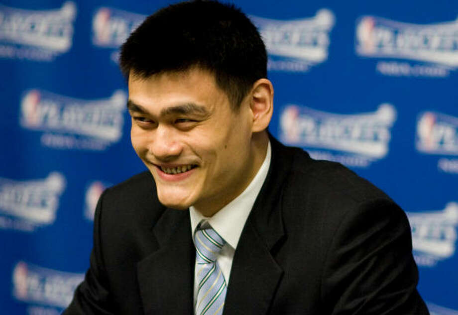 Yao Ming, who suffered a season-ending foot injury Friday, answers questions before Game 4. Photo: Nick De La Torre, Chronicle