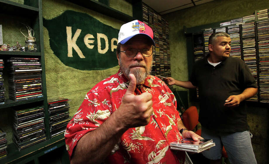 "Ricky ""Guero Polkas"" Davila, the well-known voice of KEDA ""Radio Jalapeno"" gives a thumbs up after making his last broadcast from the family-owned station, on July 29, 2011. At right is Eloy Espinoza, who will be filling Guero's spot in the morning. Photo: BOB OWEN / rowen@express-news.net"