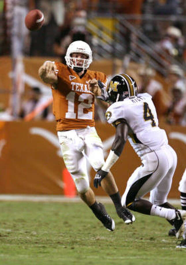 Colt McCoy and the top-ranked Texas Longhorns hope to avoid another close call against Oklahoma State Saturday. Photo: Billy Smith II, Houston Chronicle