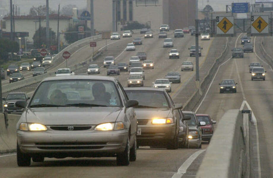 Carpooling has its obvious advantages. Some cities have converted HOV lanes to high occupancy-toll, or HOT, lanes. Houston could be the next to take that step, which would involve allowing single-occupant vehicles on three clogged freeways to use HOV lanes for a fee. Photo: Carlos Antonio Rios, Chronicle File