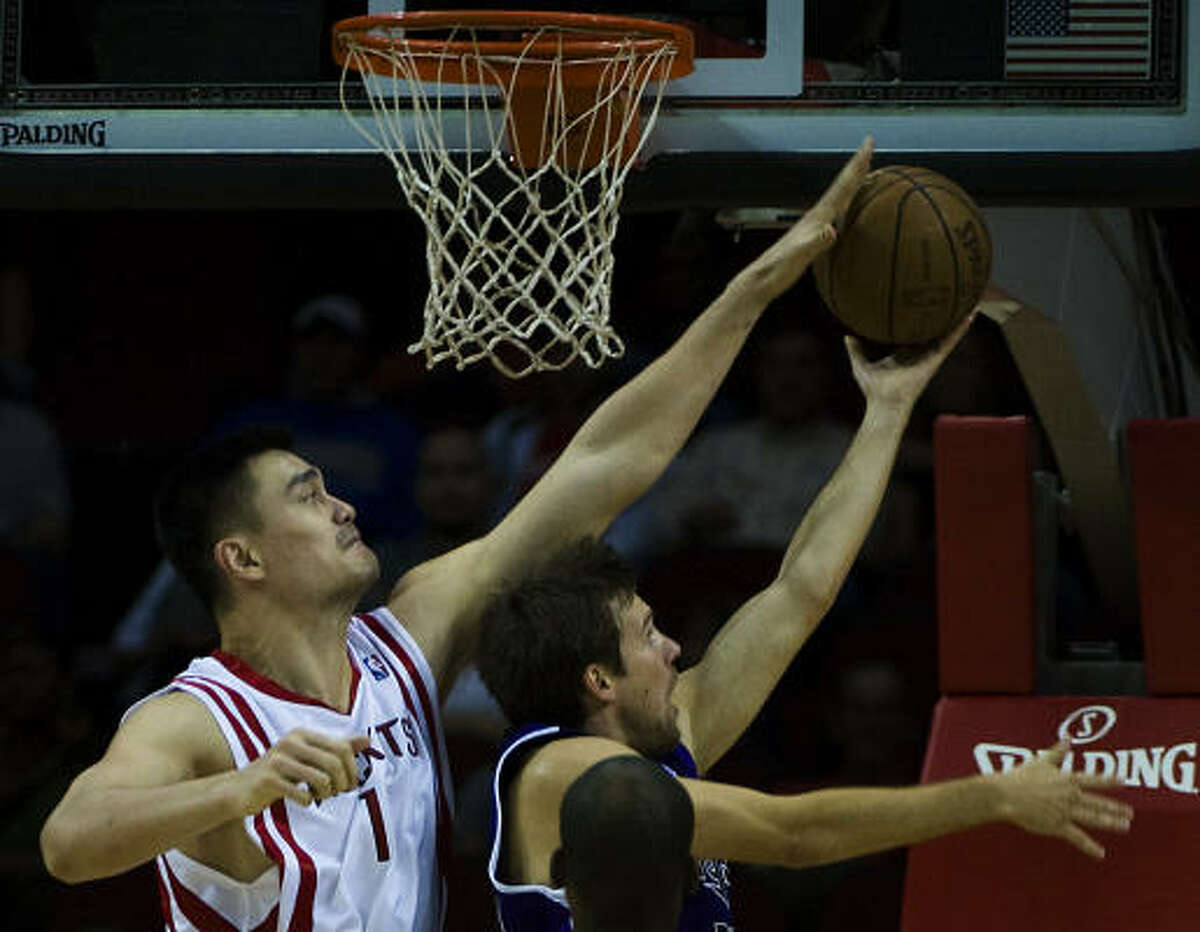 Rockets center Yao Ming blocks a shot by Sacramento Kings guard Beno Udrih in the first half on Friday at the Toyota Center.