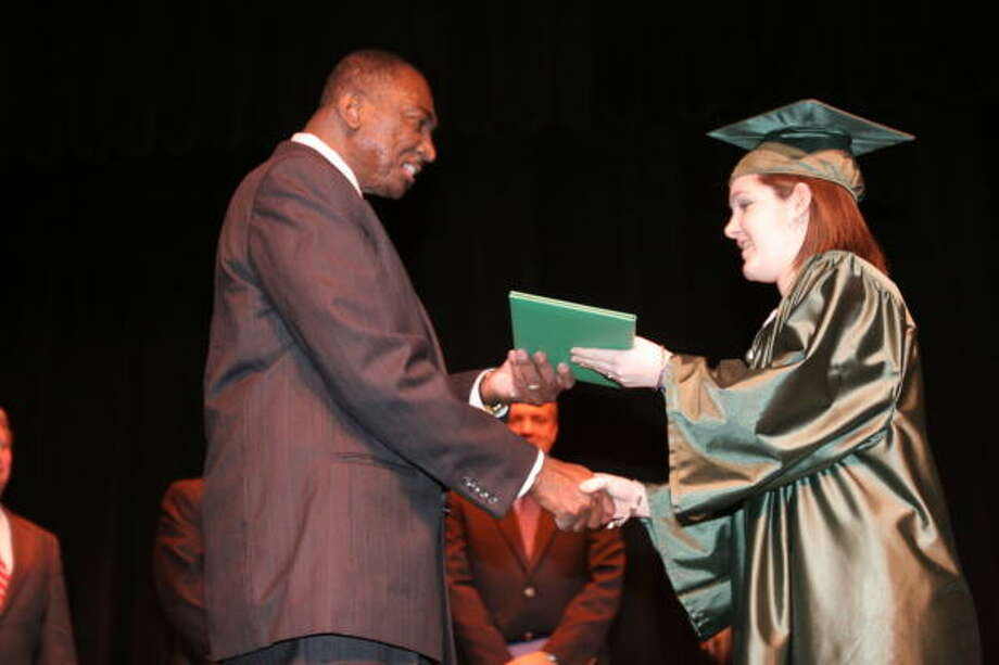 SALARIES: How much do principals at Houston's suburban high schools earn?O. D. Tompkins Jr., Mayde Creek High School principal presented a diploma to Kristina Marie Behrens the first graduation of the School of Choice.Click through the slideshow to see the salaries of high school principals in the Houston suburbs. Photo: Suzanne Rehak, For The Chronicle
