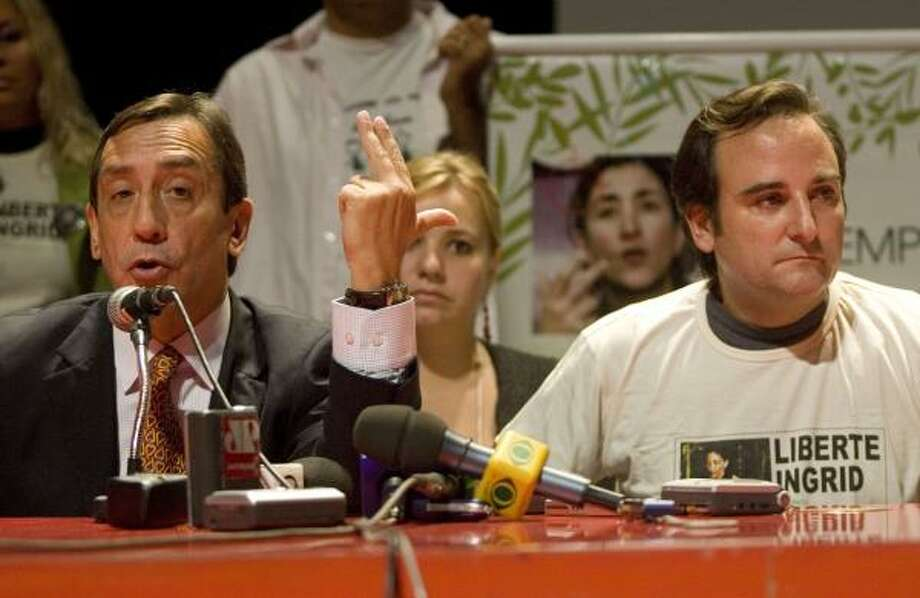 Former Colombian Sen. Luis Eladio Perez, left, who spent nearly seven years as a FARC hostage, and Juan Carlos Lecompte, husband of French-Colombian hostage Ingrid Betancourt, attend a news conference in Sao Paulo. Photo: ANDRE PENNER, ASSOCIATED PRESS