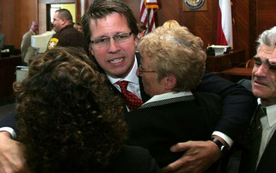 Plaintiff's attorney Mark Lanier hugs his client, Carol Ernst, after the ruling in 2005. Photo: PAT SULLIVAN, ASSOCIATED PRESS