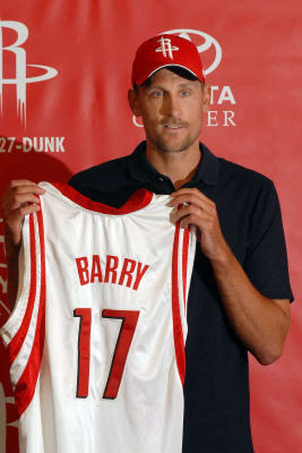Newly signed Houston Rocket Brent Barry shows off his new jersey at a press conference at the Toyota Center on Wednesday. Barry's father and brother also played for the Rockets during their respective careers. Photo: Dave Rossman, For The Chronicle