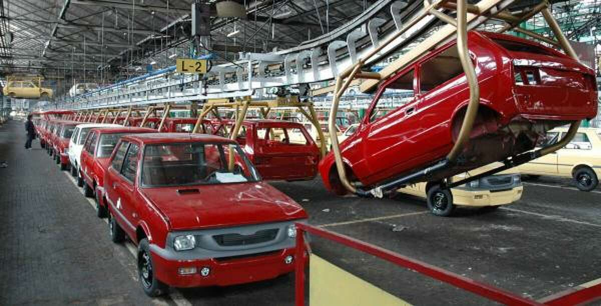 Partially assembled Yugos are lined up at the Zastava Yugo factory in Kragujevac, Serbia, earlier this month. The last of the inexpensive and much-reviled vehicles will roll off the assembly line today.
