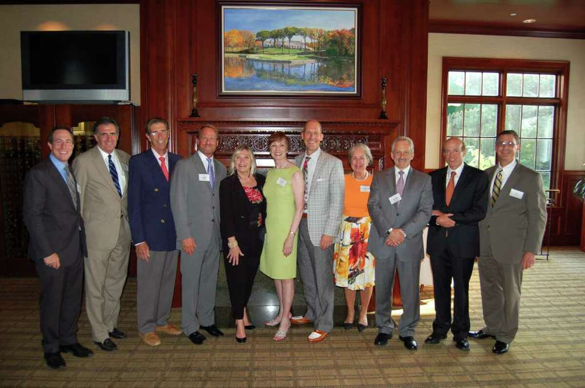 Terra Holdings co-chairman and Halstead Connecticut Executives pose at Halsteadís Summer Soiree.