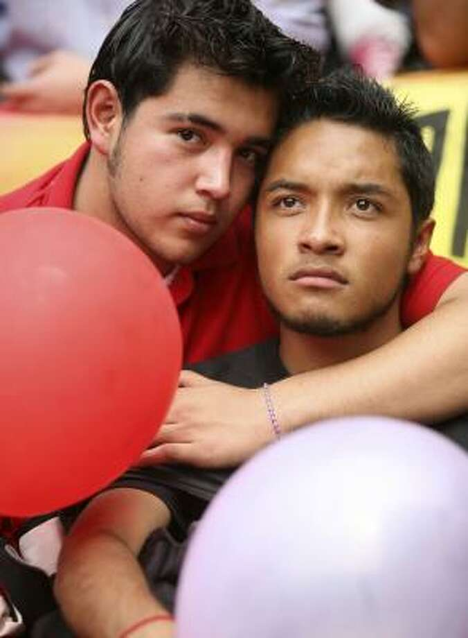 Ignacio and Carlos sit outside Mexico City's legislature on Thursday as a same-sex civil union bill was being debated. Photo: ANDREW WINNING, REUTERS