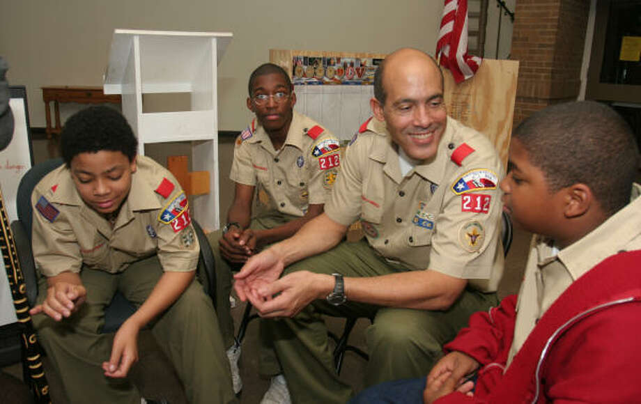 Troop 212 members Mathew Jellins, left, Alexander Denard, Scoutmaster Lionel Jellins and Ashton Ethridge discuss first aid during a meeting at St. James Episcopal Church at 3129 Southmore. Photo: Gary Fountain, For The Chronicle