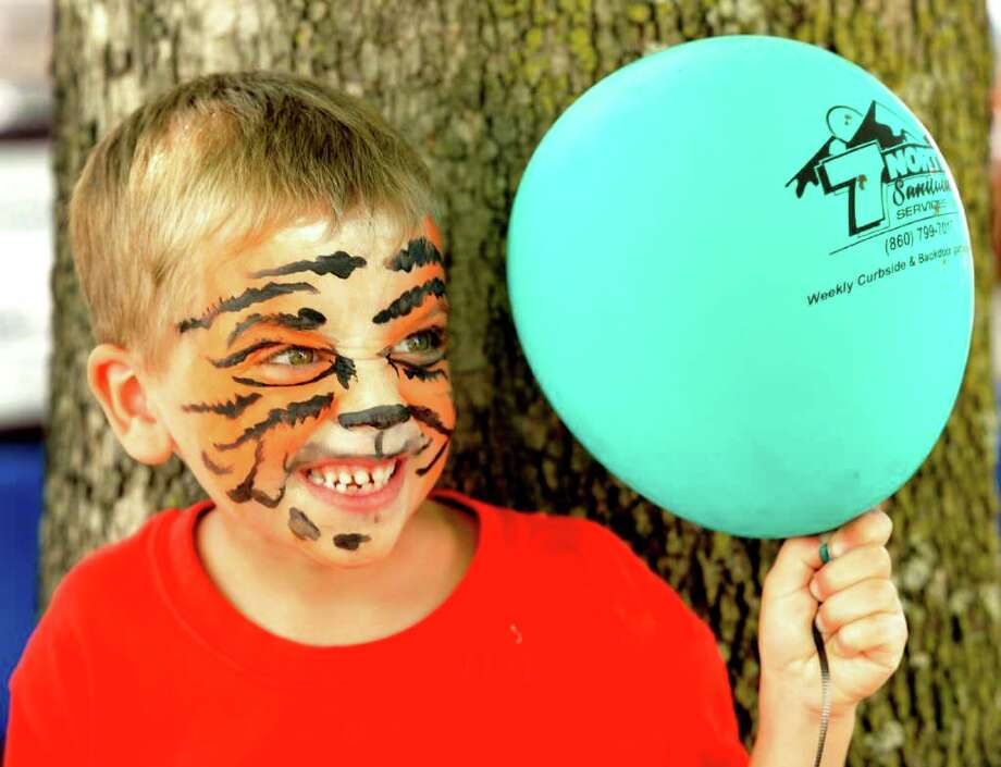 Max Barlow, 6, of Ridgefield, gives his best eye of the tiger during Village Fair Days in New Milford, Saturday, July 30, 2011. Photo: Michael Duffy