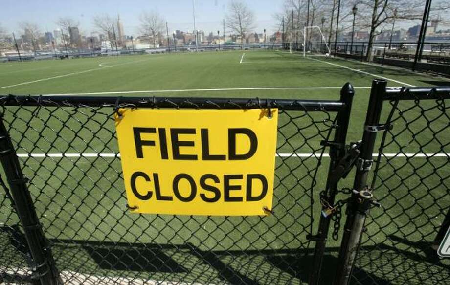 Frank Sinatra Park in Hoboken, N.J., was one of two fields closed. Health hazards from the turf are being studied. Photo: MIKE DERER, ASSOCIATED PRESS