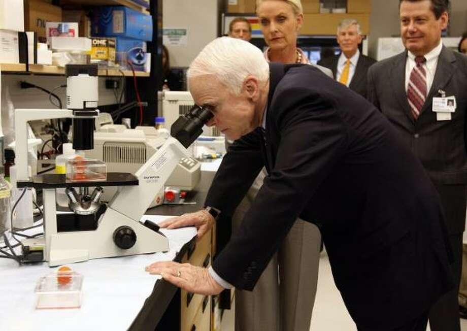 Sen. John McCain takes a tour of a cancer research center at the University of South Florida in Tampa on Tuesday. His health care plan is vastly different from the two Democrats' plans. Photo: SCOTT ISKOWITZ, POOL TAMPA TRIBUNE