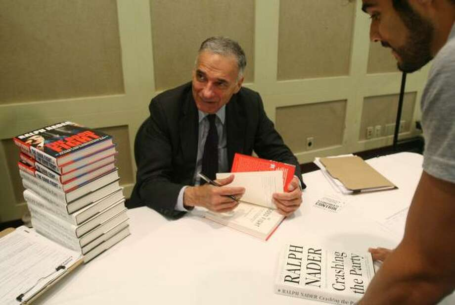 Independent presidential candidate Ralph Nader signs books and political posters during a rally Sunday at the Hilton University of Houston Hotel. Photo: MAYRA BELTRÁN, CHRONICLE