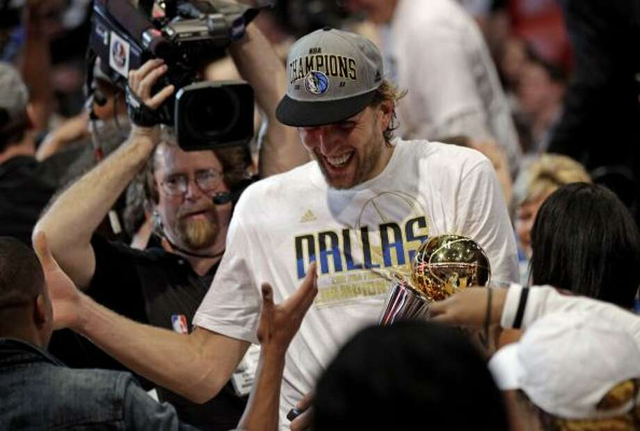 Mavericks forward Dirk Nowitzki celebrates after Game 6 of the NBA Finals. Photo: David J. Phillip, Associated Press