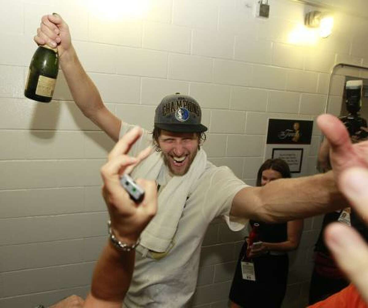 Mavericks forward Dirk Nowitzki celebrates after winning Game 6.