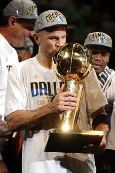 Mavericks guard Jason Kidd kisses the Larry O'Brien Trophy after beating the Heat in Game 6. Photo: Tom Fox, McClatchy-Tribune News Service