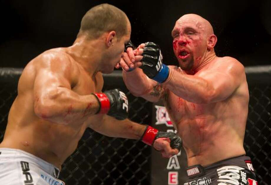 Junior Dos Santos, left, matched wits and fists against Shane Carwin during their main event heavyweight bout at UFC 131 on Saturday night in Vancouver, British Columbia. Dos Santos won by decision. Photo: Darryl Dyck, Associated Press