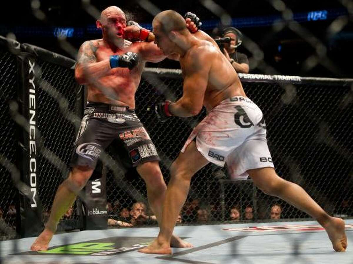 Junior Dos Santos, right, hits Shane Carwin during their main event heavyweight bout.