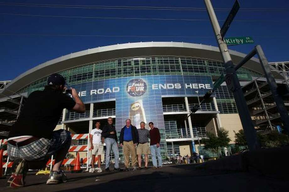 University of Connecticut fans pose for a picture outside Reliant Stadium. Photo: Johnny Hanson, Chronicle