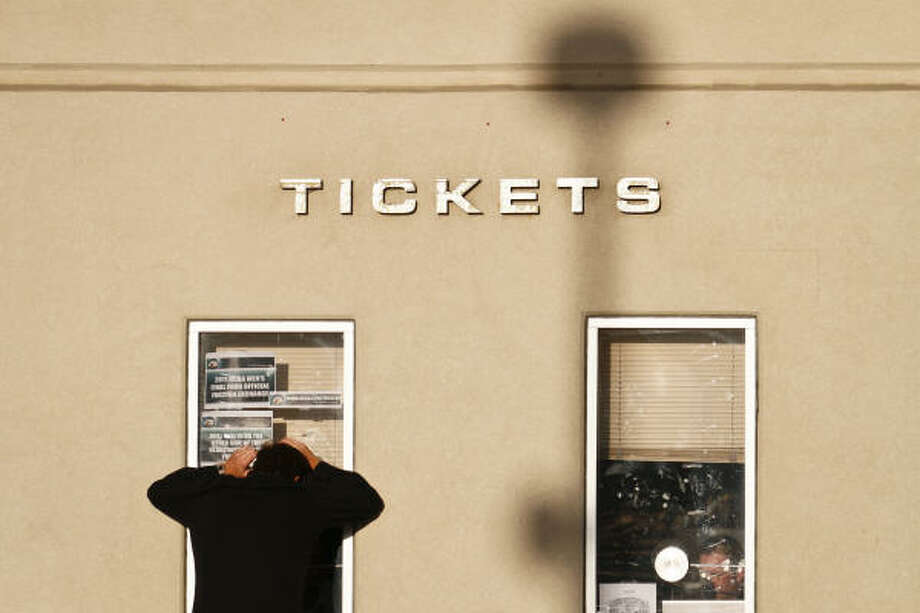 A fan looks to buy tickets at the ticket counter before the start of the Butler vs. Connecticut game. Photo: Michael Paulsen, Chronicle