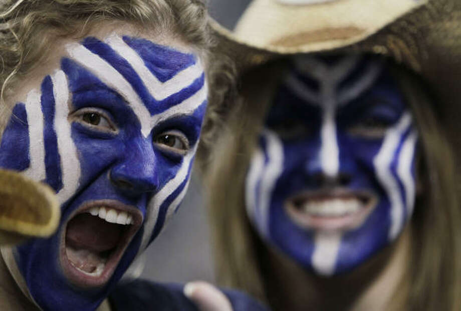 Connecticut fans watch their team warm up before the NCAA championship game at Reliant Stadium on Monday. Photo: Karen Warren, Chronicle