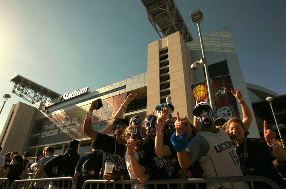 University of Connecticut students whoop it up  outside of Reliant Stadium before the start of the NCAA championship game Monday. Photo: Johnny Hanson, Chronicle