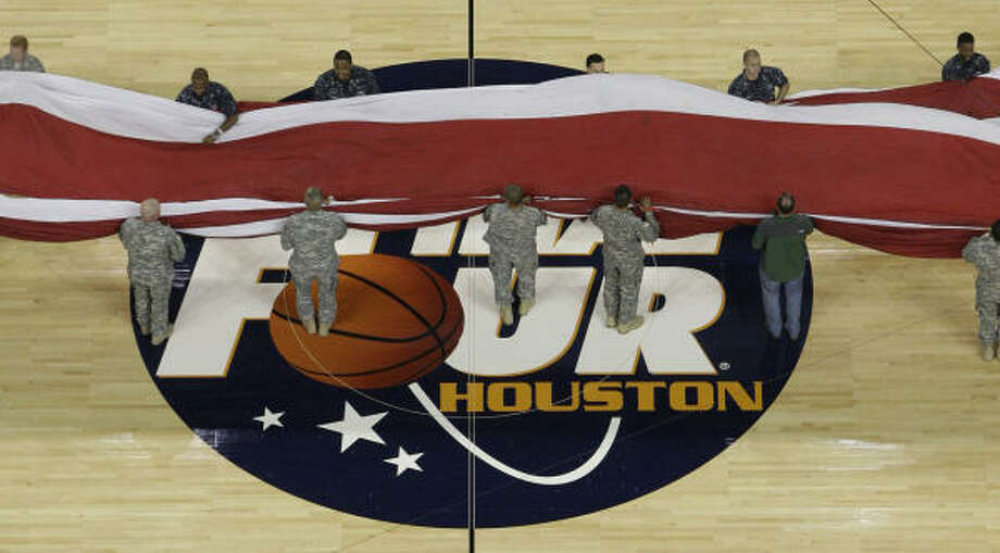 Armed Services representatives rehearse for pregame ceremonies Monday before the championship game. Photo: Nick De La Torre, Chronicle