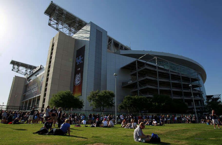 Butler and UConn students wait outside of Reliant Stadium on Monday.