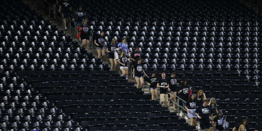 Butler fans head for their seats after the doors open at Reliant Stadium. Photo: Brett Coomer, Chronicle