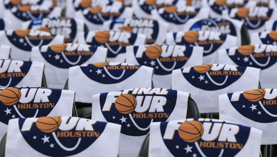 Final Four towels are set out on seats for fans before they arrive at Reliant Stadium on Monday. Photo: Brett Coomer, Chronicle