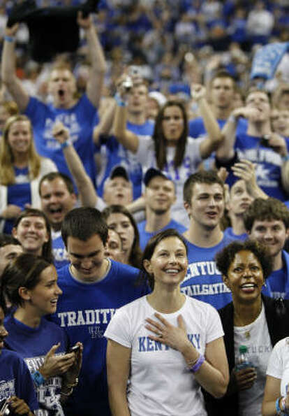 Actress and Kentucky native Ashley Judd smiles before the first half of the Kentucky vs. UConn match