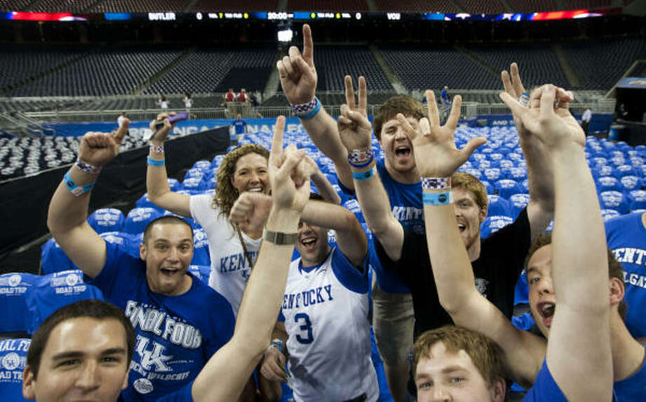 Kentucky fans cheer as they enter the stadium. Photo: Brett Coomer, Chronicle