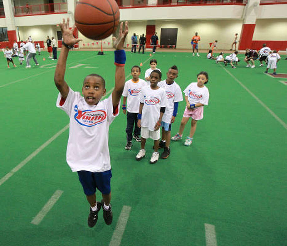 Michael J. Prince jumps for a basketball while participating in a drill during the Powerade NCAA Youth Clinic at the University of Houston Saturday. Photo: James Nielsen, Houston Chronicle